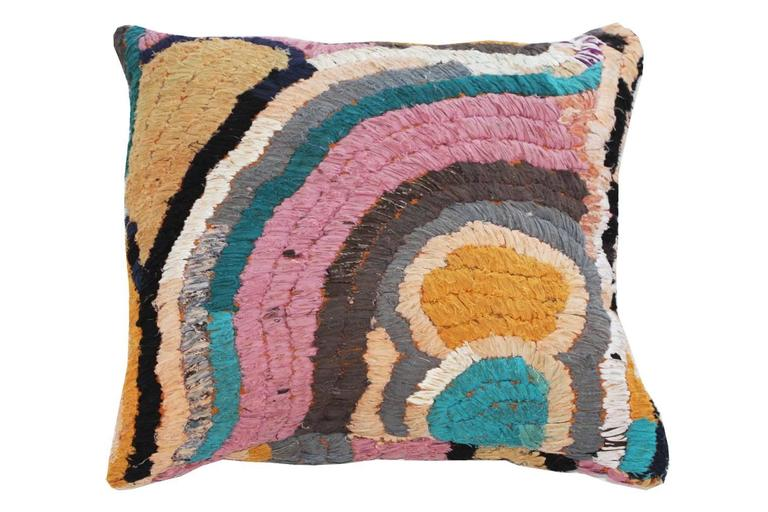 """Floor pillow made with a Moroccan vintage textile rug.  This pillow is pink, black, gray with accents of orange, aqua and brown.  Measures: 28"""" L x 26"""" W."""