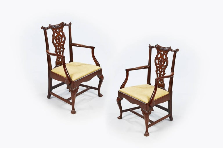 19th century set of eight (two carvers and six singles) Chippendale style dining chairs with finely carved back splat with gold upholstered drop in cushioned seat supported on cabriole leg with acanthus carving on knee terminating on carved strap