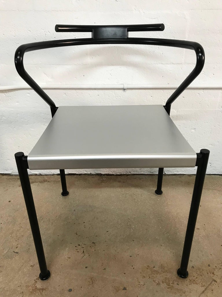 Set of ten Postmodern chairs with a black enameled steel frame and aluminum seat by Cidue.