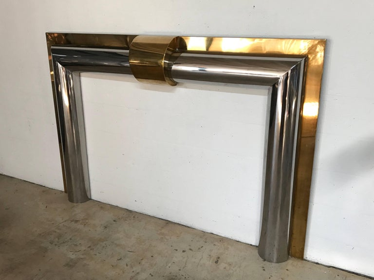 """Polished brass and steel fireplace mantel, custom-made in 1970 for a waterfront mansion in Palm Beach.  Fire box dimensions: 52"""" wide 38"""" high."""