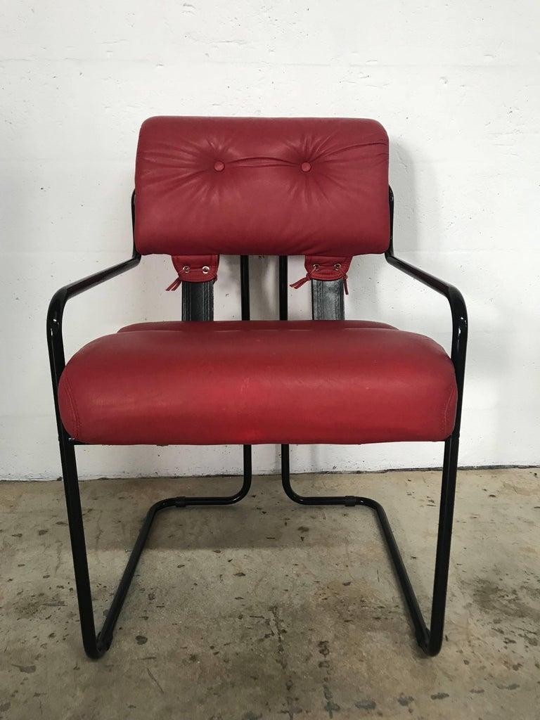 Rare black enameled dining chairs with red leather seats and back designed by Guido Faleschini for Pace Collection and manufactured by i4 Mariani in Italy.