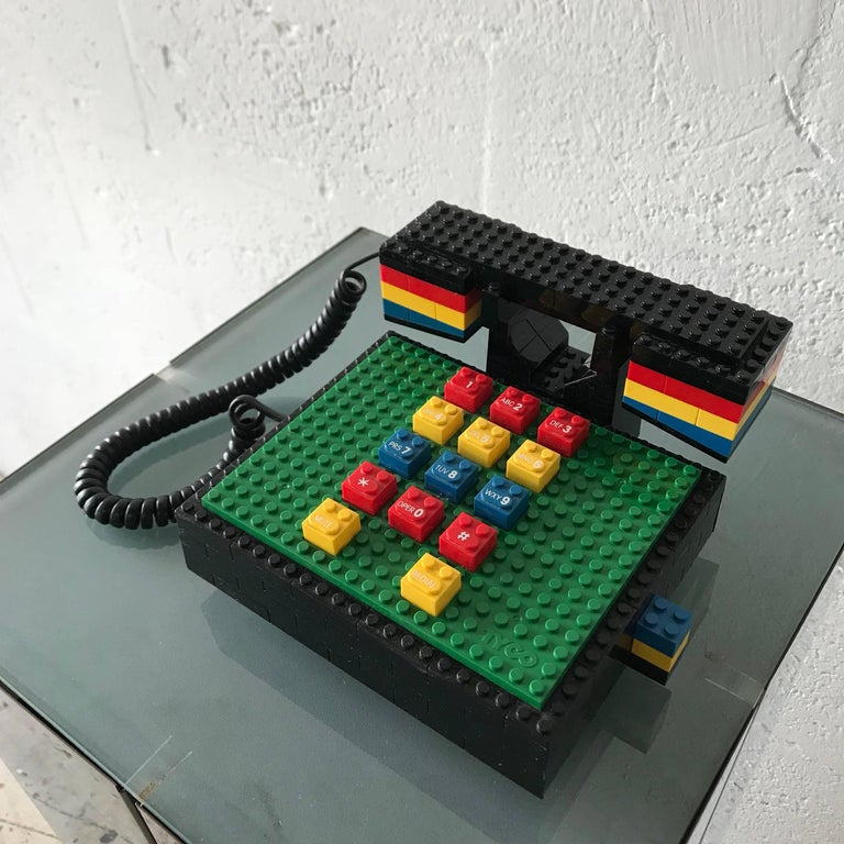 Iconic Postmodern LEGO telephone rendered in multicolored LEGO's by Tyco.