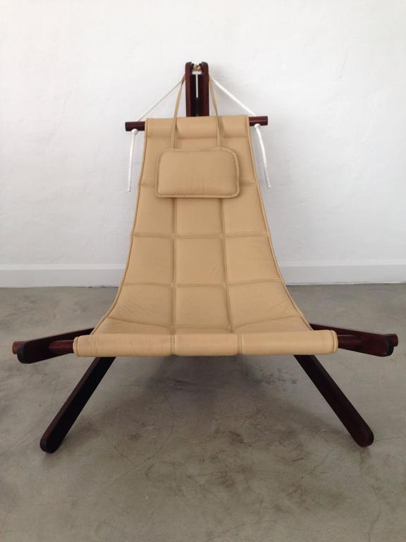 Rare and collectible sling chair in Cherry (Jatoba) wood, cream leather and rope by British architect Dominic Michaelis for Moveis Corazza, Brazil.