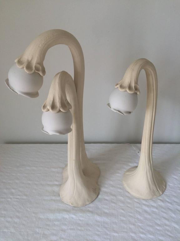 Pair of Art Nouveau pottery lamps, artist signed.