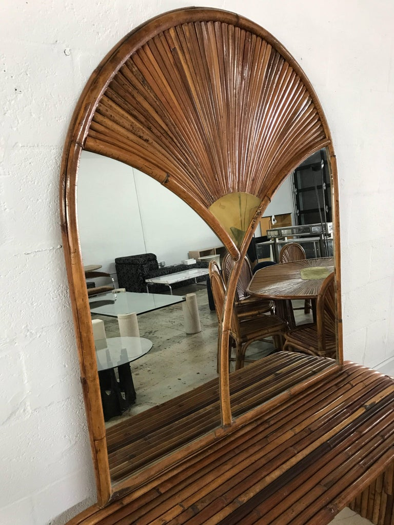 House of the Rising Sun collection rattan and brass console or wall mirror by Gabriella Crespi, documented.