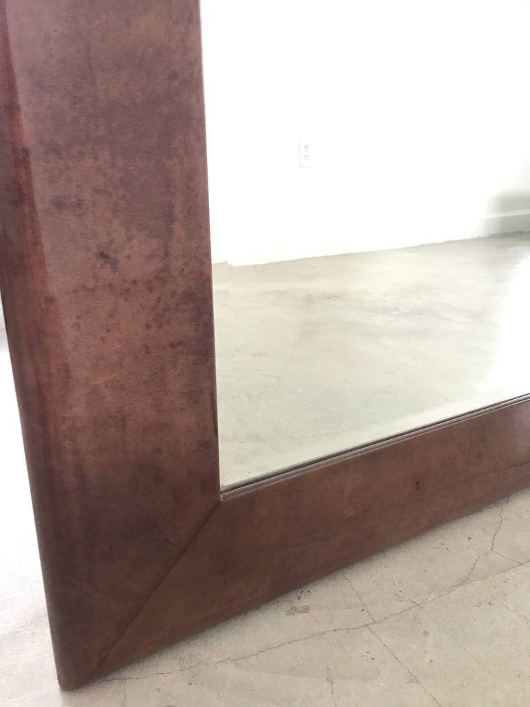 Purple tinted goatskin wall mirror by Aldo Tura.  Two mirrors available.