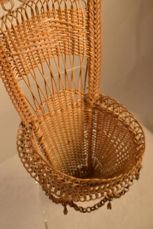 Handmade wicker work basket with chain loops and tassels. Bottom of basket does have wear and tear.