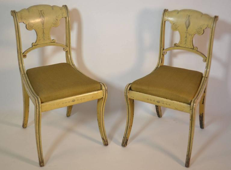 Set of four small painted chairs with mustard colored paint.