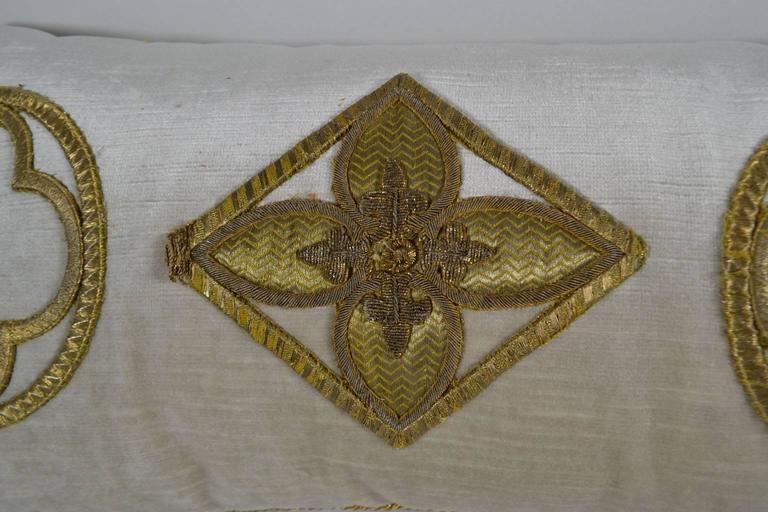 Antique raised gold metallic embroidered appliqué pillow, on oyster velvet. Down filled.