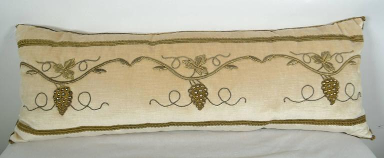 Antique raised gold metallic embroidery pillow, on vanilla velvet. Down filled.