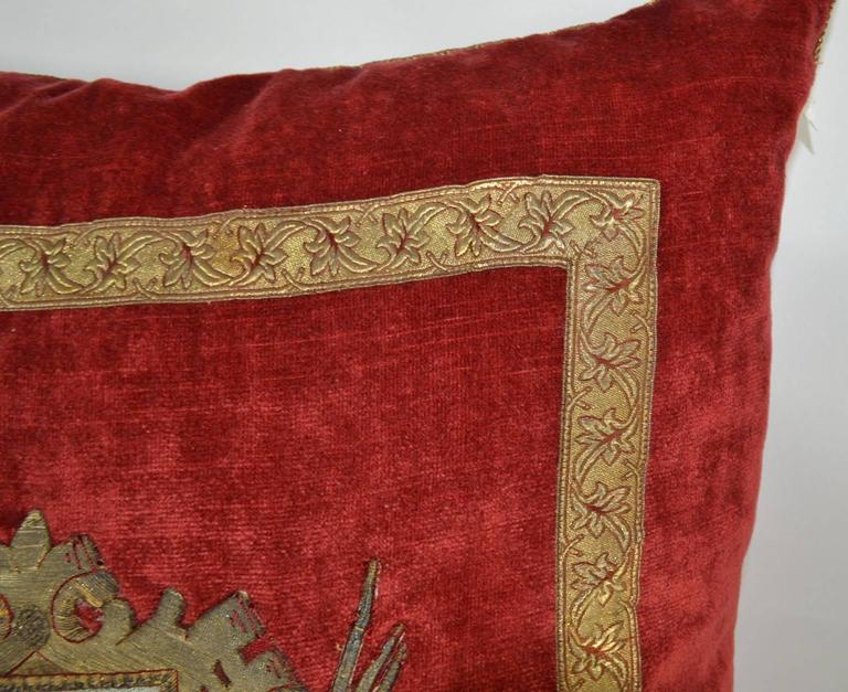 North American  Pillow with Red Velvet Fabric and Antique Trim and Crest