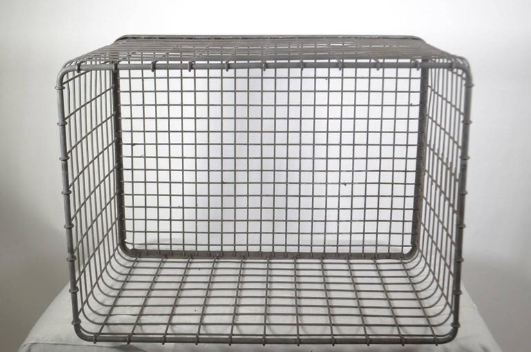Metal basket used in factory which made car parts, circa 1950-1960.