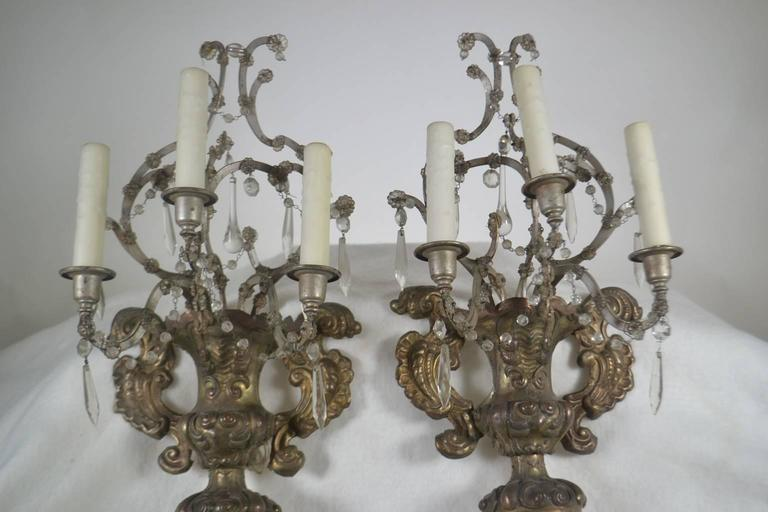 French, 18th century, pair of silver reposse three-arm wall sconces with crystals.