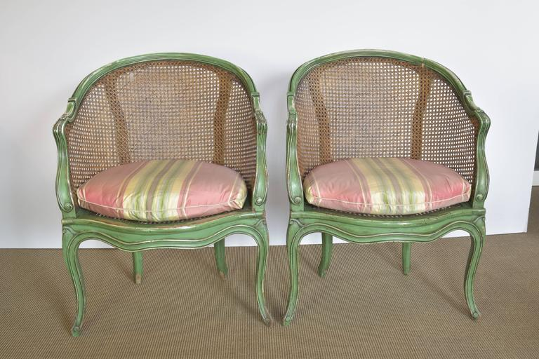 Pair Of Green Painted French Chairs With Original Caning And New Silk Seat  Cushions. These