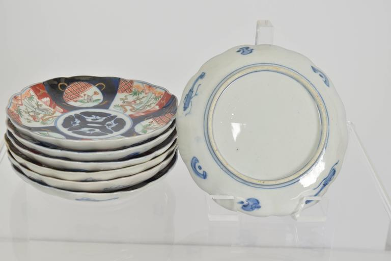 Collection of seven hand-painted Imari porcelain decorative plates.