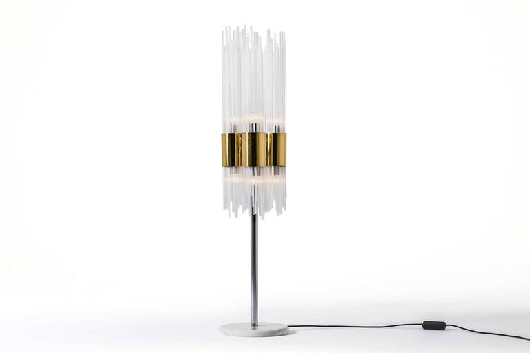 Impressive table, floor lamp, Italy, 1970s. Beautiful combination of clear and opal white glass tubes mounted in brass cylinders. Nice combination between the brass cylinders and the chrome base which is mounted on a beautiful piece of white marble