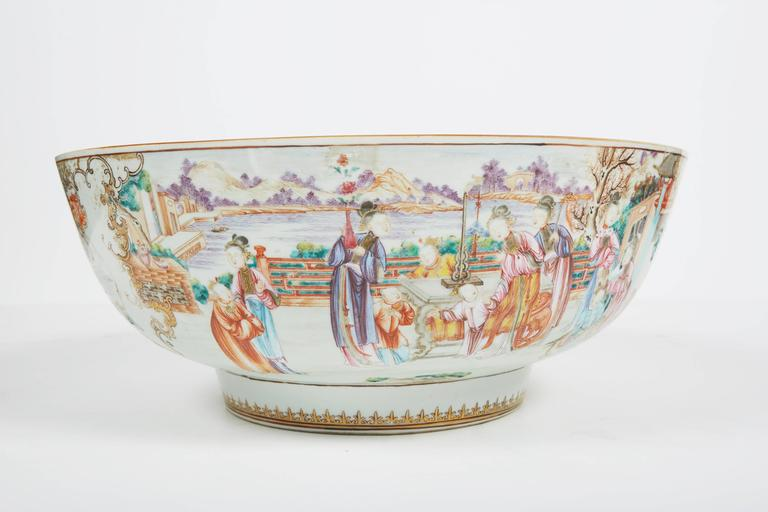 Large 18th century Chinese export punch bowl in the Rockefeller pattern (also known as Chinese Export Palace Ware). Elaborate gilt decoration with decorated larger reserves beautifully painted in a famille rose pallette showing Mandarin scenes and