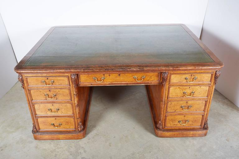 Early 19th century burl walnut double sided partners desk with a central drawer on both sides. One side is fitted with columns of drawers on either side of the central drawer and the other side is fitted with cupboards on either side of the center