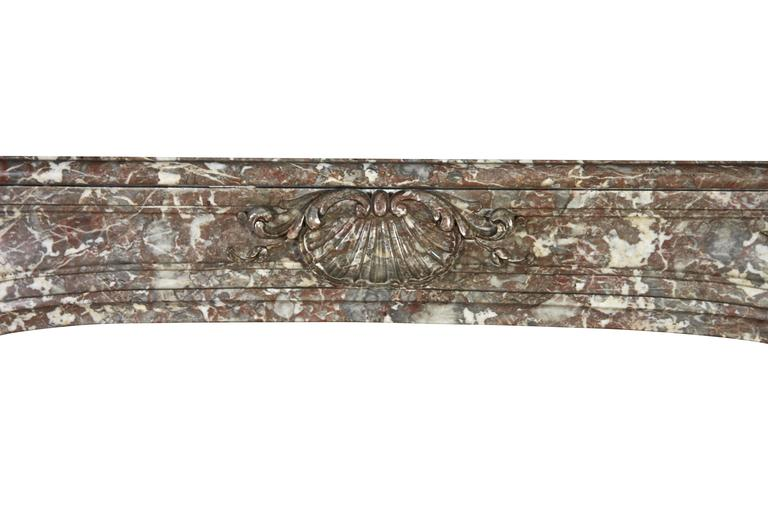 Carved 18th Century Belgian Marble Antique Fireplace Mantle from the Regency Period For Sale