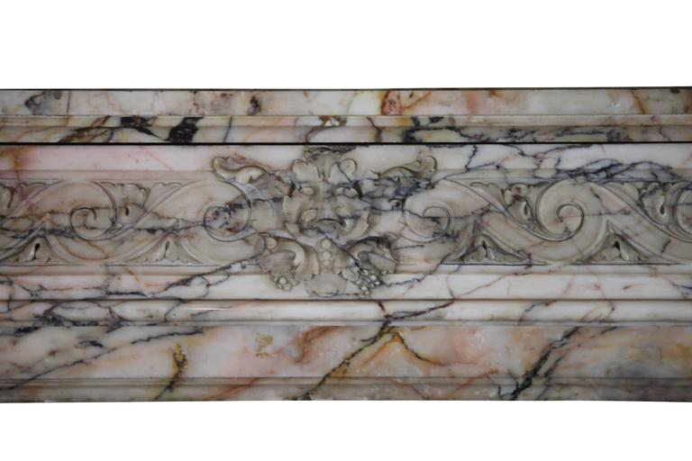 This is a very nice original fireplace surround in Louis XVI style with good proportions. The marble is very elegant.