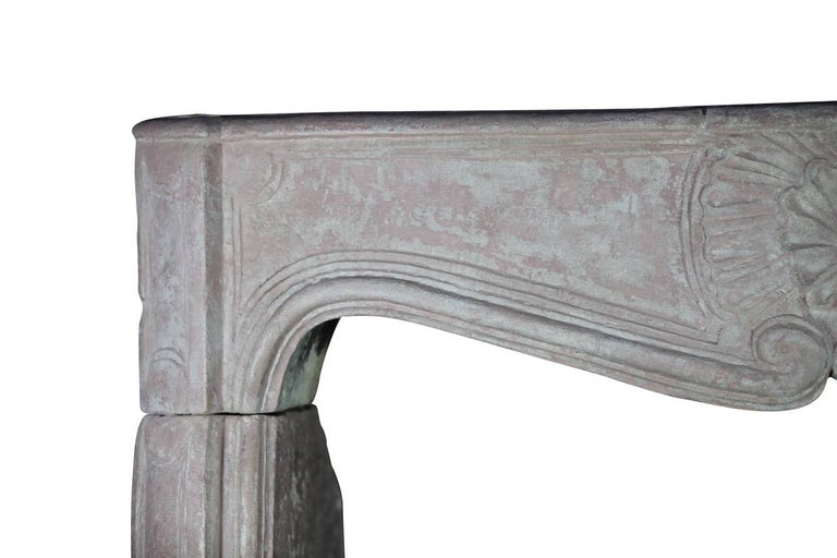 This original fireplace surround has exceptional proportions. The Burgundy hardstone is partly covered by remains of the original polychrome. This mantel brings an elegance to any type of interior. Measures; 137 cm EW 53,94