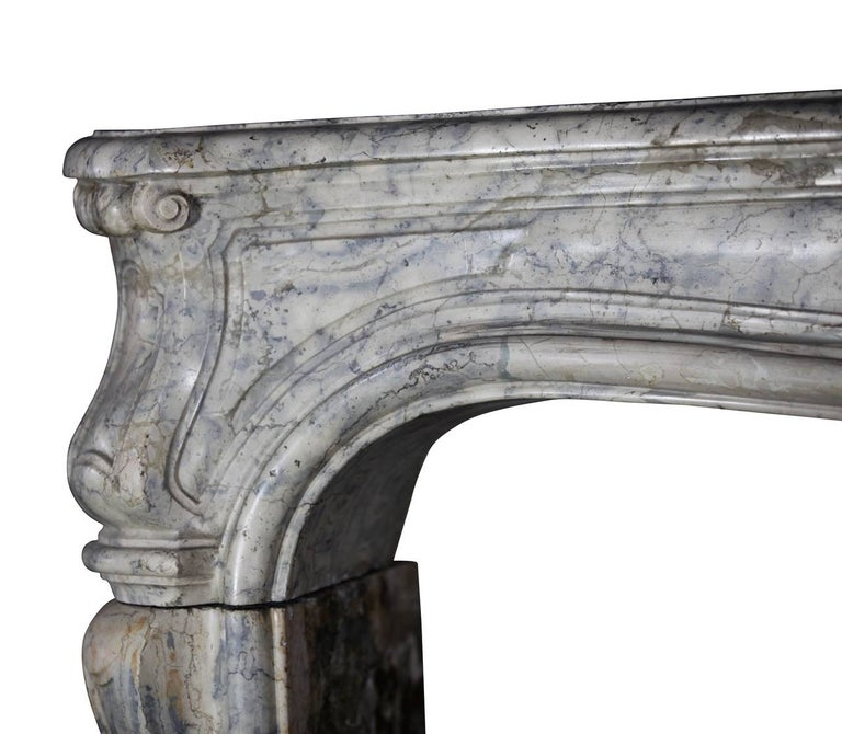 This is a very unique marble-hardstone original antique fireplace surround. The hardness of the stone reflects the light in the room. Only a few mantels were carved out of this kind of marble. All of the mantels in our inventory, in this particular