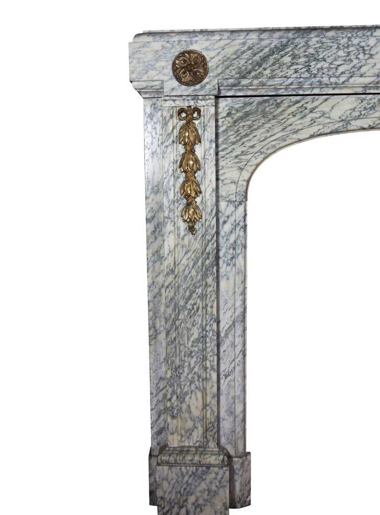 The combination of the 20th century Campan vert marble with brass and the craftsmanship is an example of the Belgian arts and the industry. This mantel (fireplace) was installed in an Art Deco house in Brussels. The veining of the marble was