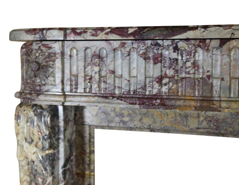 This original 18th century Royal French Saracolin marble fireplace surround is from the Louis XVI period. It has rounded corners and an exceptionally rich and brilliant color combination. The mantel is in perfect condition. It is stunning and