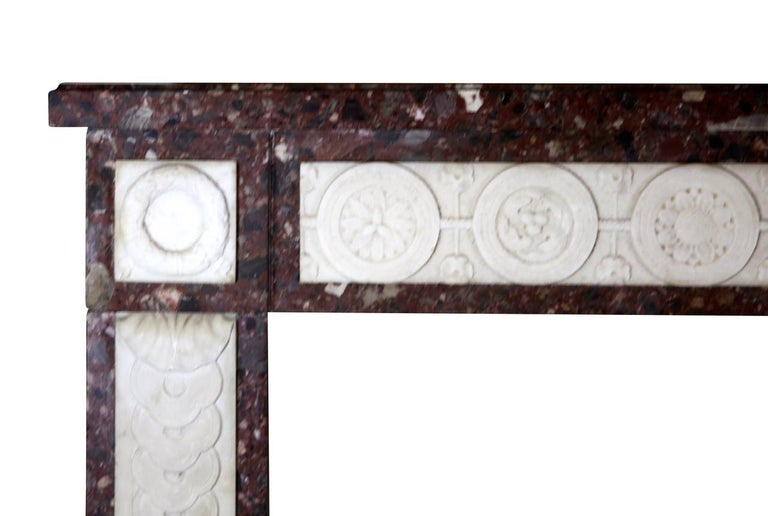 A Brêche marble with white statuary marble inlay is a perfect combination for this vintage chimney piece. The carving is of an exceptional quality built in the 18th century. Perfect for a luxury home decor with or with lots of color. A one of a
