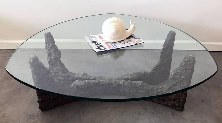 Cast metal bronze coffee table in the style of Paul Evans; very heavy. Glass top measures 40