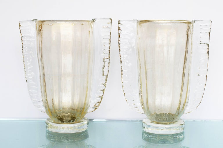 Murano hand blown vases of opaline glass made by prestigious Italian glassblower, Sergio Costantini. Clear glass with polvere d'oro (23-karat gold leaf flecks) is layered over white opaline glass, creating beautiful