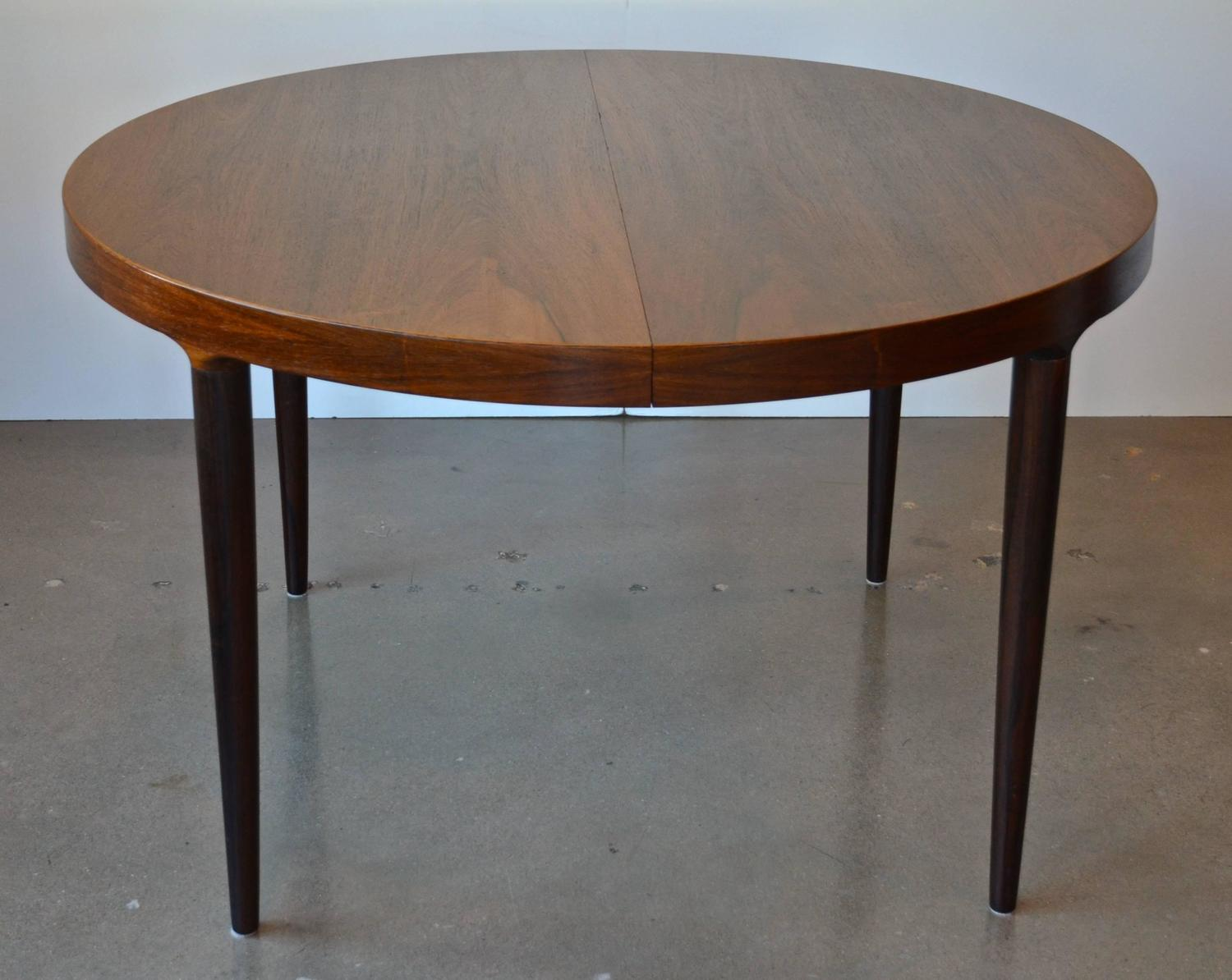 mid century round or oval rosewood dining table with