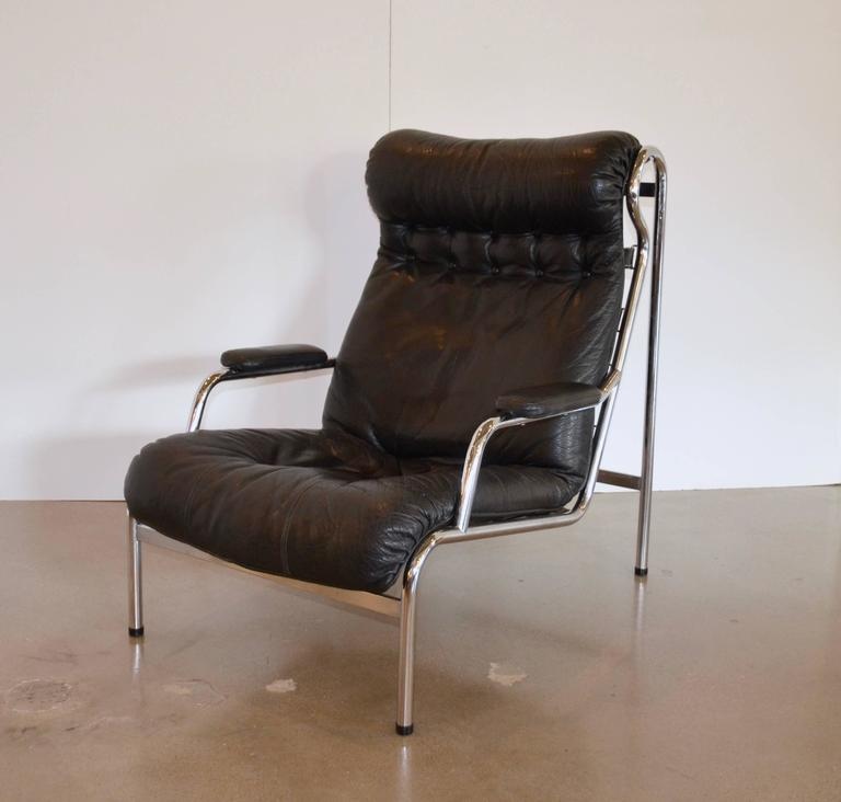 high back black leather and chrome lounge chair attributed