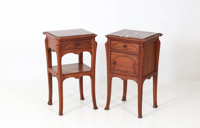 Elegant pair of French Art Nouveau nightstands or bedside tables.