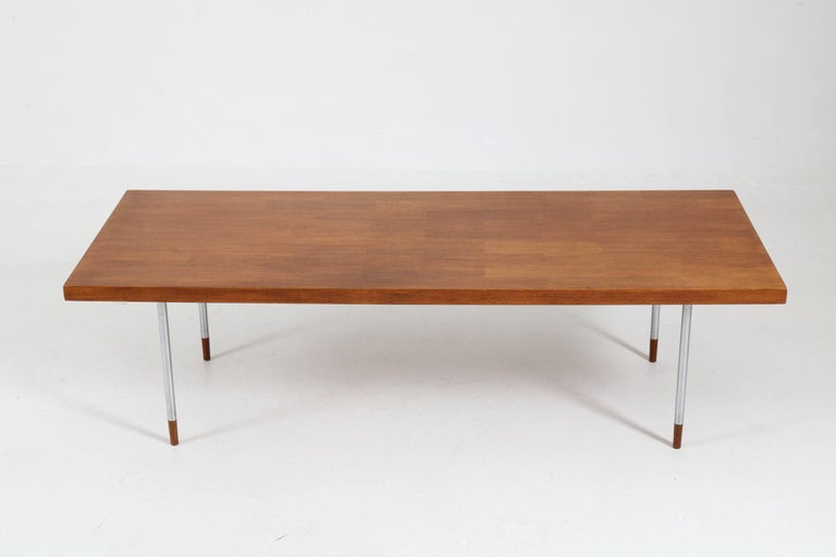 Funky Mid-Century Modern coffee table by Rudolf Bernd Glatzel for Fristho. Teak top with original chrome legs. Striking design from the 1960s. In good original condition with minor wear consistent with age and use, preserving a beautiful patina.