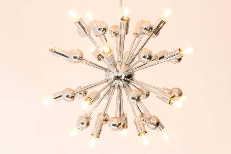 Stunning chrome French Mid-Century Modern Sputnik chandelier, 1970s. Elegant design from the seventies. In good original condition with minor wear consistent with age and use, preserving a beautiful patina.