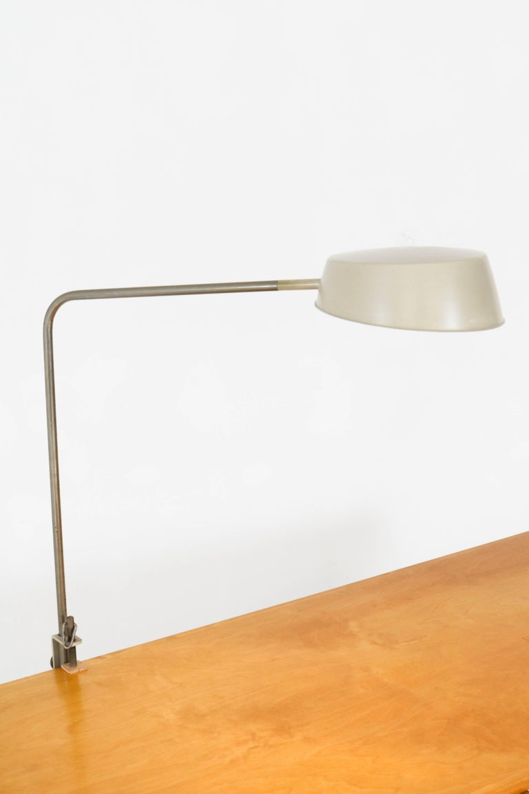 Rare Mid-Century Modern desk lamp by ASEA, Sweden. Striking design from the 1960s and adjustable in height. Grey lacquered metal and marked ASEA. In good original patina with minor wear consistent with age and use, preserving a beautiful patina.