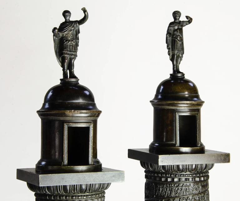 """Trajan's and Marcus Aurelius' Columns, Pair. Patinated bronze on white marble. Measures: 34-1/2"""" H, circa 1820. Hopfgarten & Jollage, Rome.  The offered matched pair is mounted on original white marble bases, with identical patinas. The"""