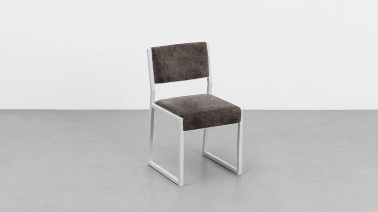 The Bandholz dining chair is a variation on our Hulihee dining chair. The low back and boxed leg has a distinctly contemporary look.  COM - Fabric not included in the cost