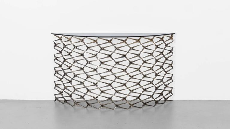 The Fenced-In demilune is made from repurposed cast-iron fence pieces in a traditional Art Deco repeat design. Originally inspired by the ornate iron work common on Brooklyn brownstones in neighborhoods surrounding the Uhuru workshop, the Fenced-In