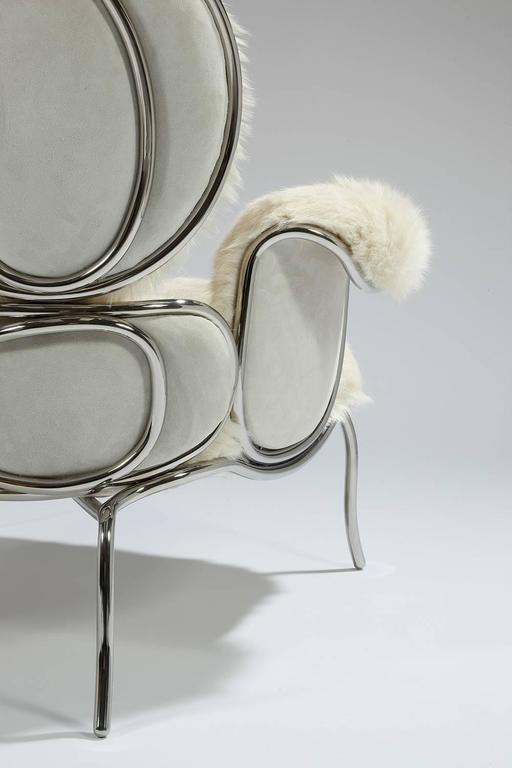 Mattia Bonetti Armchair and ottoman 'Big Jim'  2008. Nickel-plated steel frame, fur/couture fabric, suede. Chair: H 96 x L 96 x D 86 cm / H 37.8 x L 37.8 x D 33.9 in.  Ottoman: H 27 x L 57 x D 53 cm / H 10.6 x L 22.4 x D 20.8 in. Editions