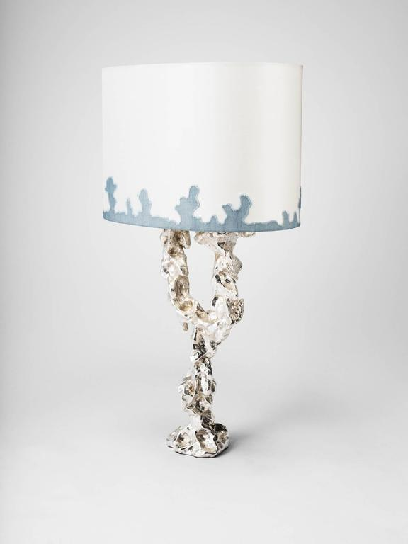 Mattia Bonetti table lamp 'Grotto,'  2014. Silver plated bronze, silk shade. Measures: H 45 x L 31 x D 21 cm / H 17.7 x L 12.2 x D 8.3 in. David Gill Gallery. For EU buyers this piece is subject to a 20% VAT tax, which will be added to the price