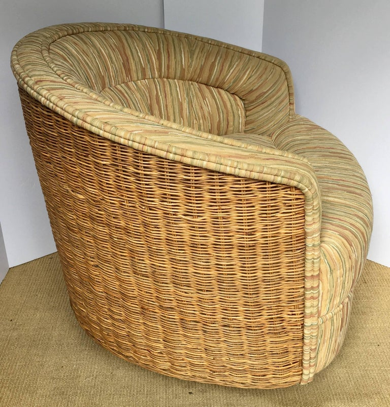 Rare Mid-Century Modern natural woven rattan/wicker barrel lounge chair in the style of Milo Baughman. 