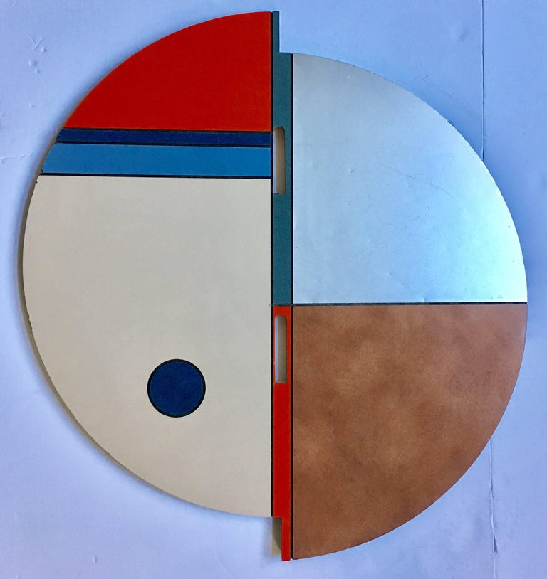 Mid-Century Modern Memphis style color blocked round occasional side or end table.  Top and legs feature a colored and brushed stainless laminate. This unusual lightweight four legged plywood table could also be used as a small café or pub dining