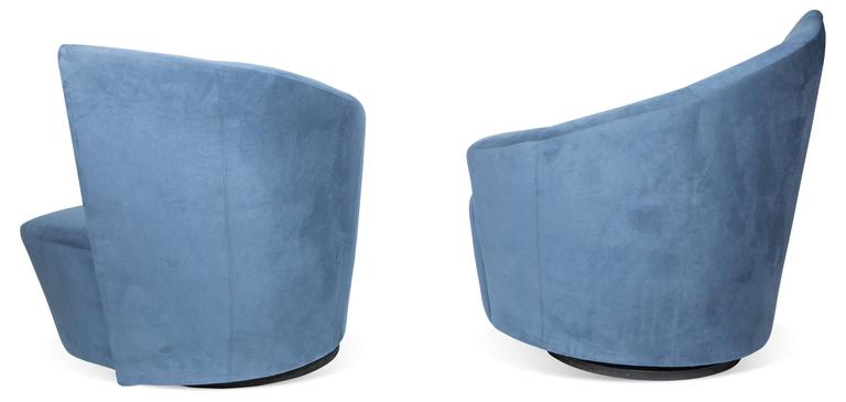 Pair of sculptural Bilbao swivel lounge chairs designed by Vladimir Kagan for Weiman preview features comfortable plush seats and curved angular backrests/armrests. The Bilbao collection was inspired by Frank Gehry's Guggenheim Museum in Bilbao,