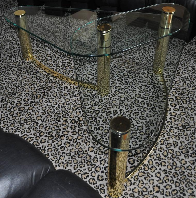Sculptural Mid-Century Modern two-tier tubular brass-plated and glass coffee table. This boomerang shaped cocktail table is the style of Pace Collection.