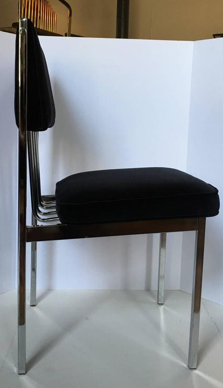 Beautiful set of four Mid-Century Modern chrome frame dining chairs featuring a sculptural tubular back design.  Newly upholstered in Italian black velvet fabric with new seat and back cushion inserts/foam.  In the style of Milo Baughman.
