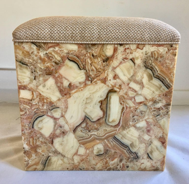 Mid-Century Modern custom onyx and resin rectangular form bench or ottoman. Base features onyx/stone veneers set in high gloss resin. The seat has been newly upholstered in an Italian Kravet fabric.