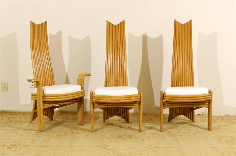 A fabulous set of six high back rattan dining chairs. A modern interpretation of the Classic Mackintosh style. Extremely comfortable and beautifully made. There are two host and four side chairs. While unmarked, the pieces are consistent with the