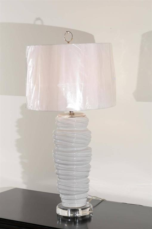 A stunning pair of late 20th century vessels as lamps. Fabulous ceramic form that recalls the look of soft serve ice cream. Beautiful scale and texture. Exceptional jewelry! Excellent restored condition. Wired using clear cord; new nickel three-way